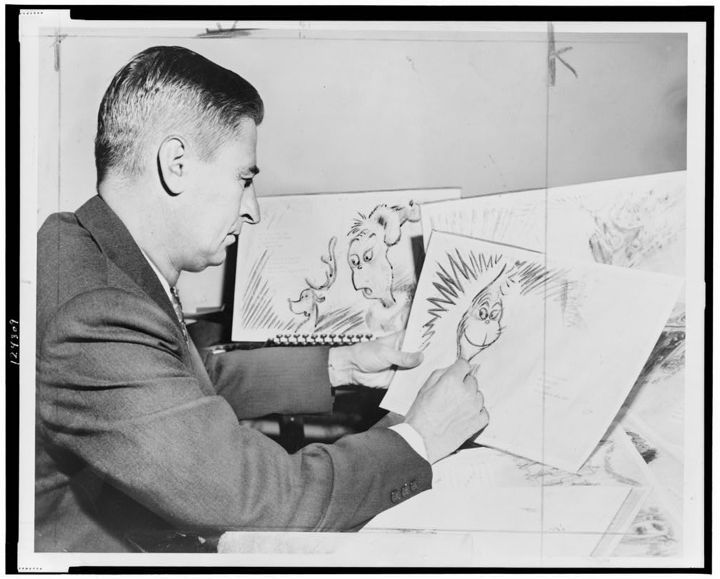 Photo of Dr. Seuss drawing the Grinch