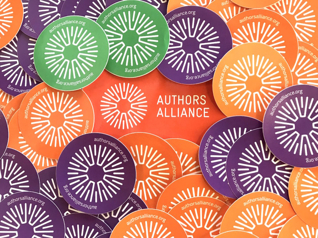 Photo of Authors Alliance logo stickers in orange, green, and purple