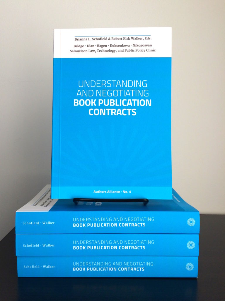 stack of blue publication contract books