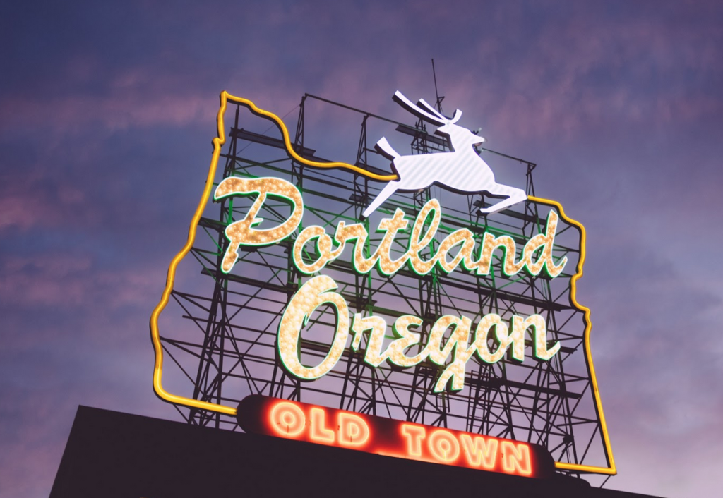 Old Town Portland neon sign against an evening sky