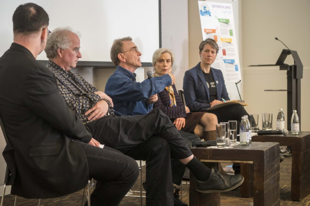 Photograph of panel: Jeff MacKie Mason, Brewster Kahle, Randy Schekman, Abby Smith Rumsey, and Molly Shaffer Van Houweling
